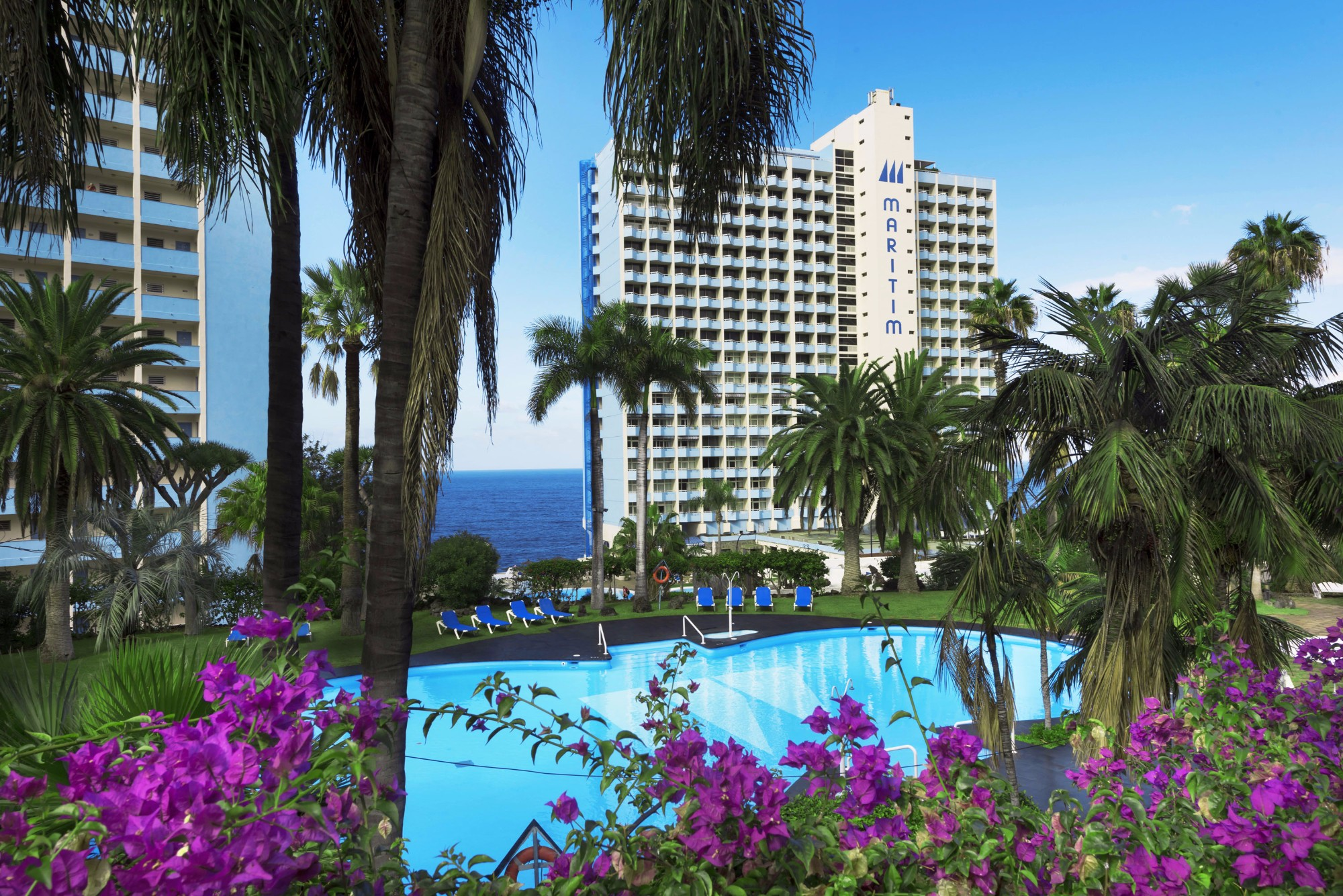 Pool mit Gebäude Ferienwohnung Hotel Maritim